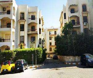 Apartment for sale in Zizinia compound New Cairo in front of AUC